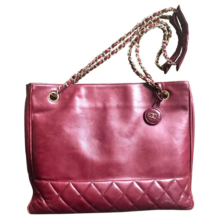 Chanel Vintage wine leather tote bag with gold chain handles and CC motif charm