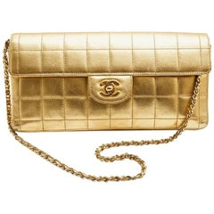 CHANEL Baguette Bag in Gilded Quilted Leather