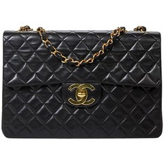 Maxi Jumbo Front Pocket in black vertical quilted caviar leather
