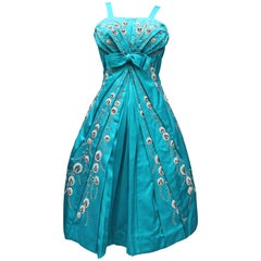 Modissa turquoise satin cocktail dress with bead embroideries