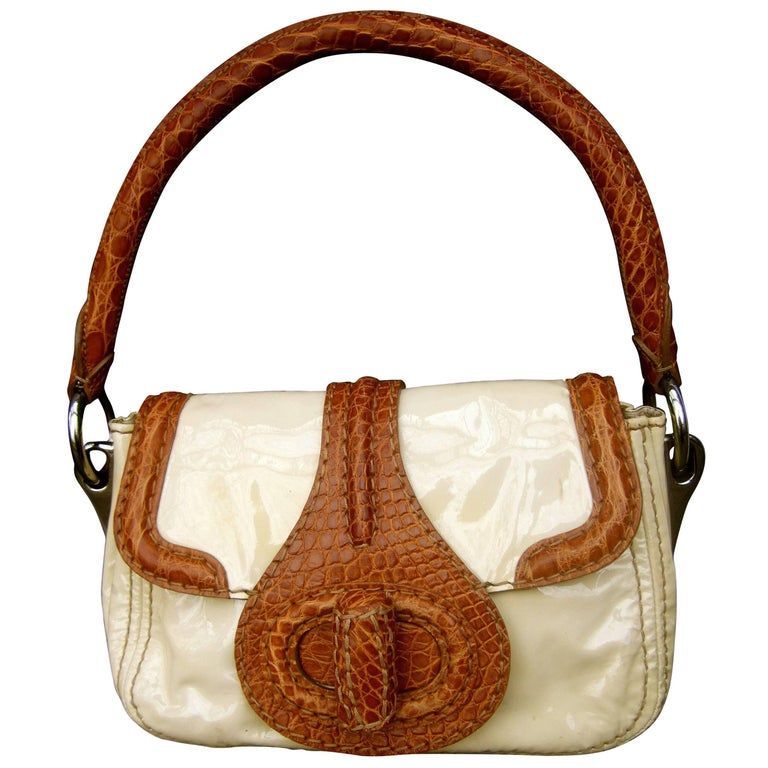 0d4022c44f Amazon com Prada Concept brown leather Handbag With Shoulder Strap 1BA175  Cognac Bianco Clothing Source · Prada Milano Tan Patent Leather Embossed  Trim ...