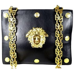 Vintage Gianni Versace black leather tote bag with big golden medusa motif. Rare