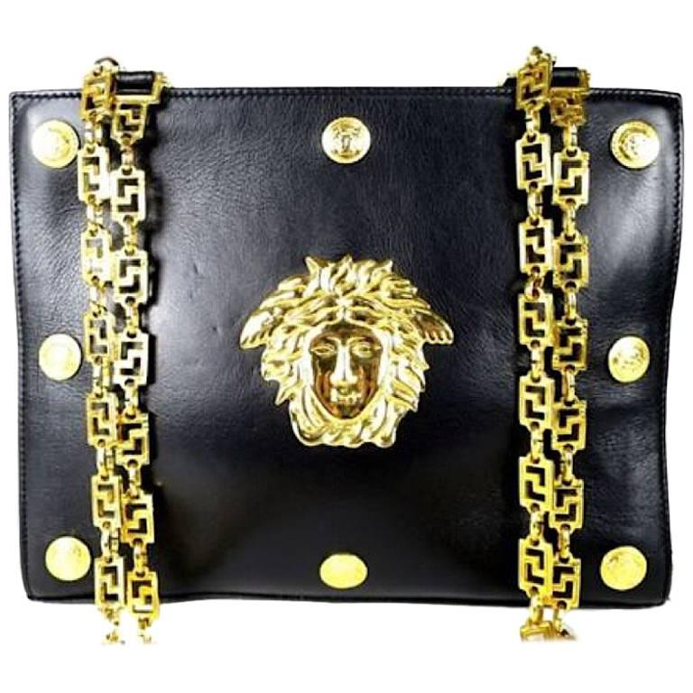 Vintage Gianni Versace black leather tote bag with big golden medusa motif. Rare