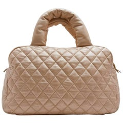 CHANEL 'Cocoon' Bag in Gold Quilted Leather