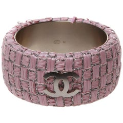 Chanel Medium pink woven cuff with three CC logos