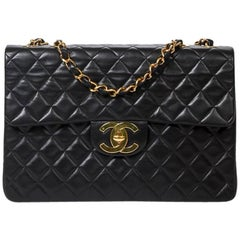 Chanel Maxi Jumbo Front Pocket in black calf leather