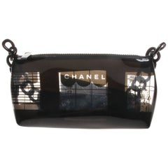 Chanel vinyl baguette with a black and transparent window graphic print