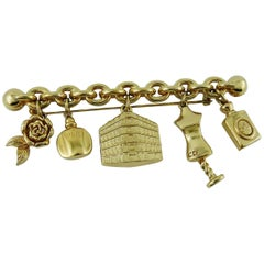 Christian Dior Gold Toned Brooch with Charms