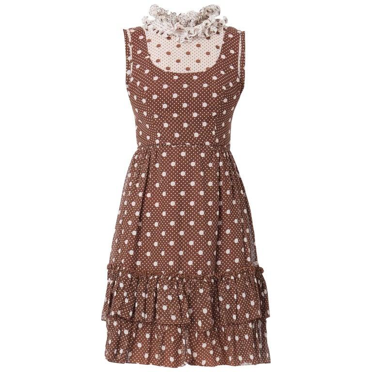 Brown & white polka dot sleeveless dress, circa 1968