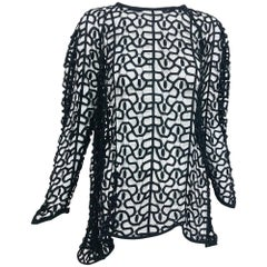 Black open work embroidered top
