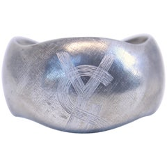 1985 YVES SAINT LAURENT silver toned logo cuff