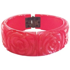 Art Deco deeply Carved Bakelite Hinged Clamper Bangle in brilliant Ruby red