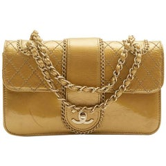 CHANEL Bag in Aged Gold Color Patent Leather