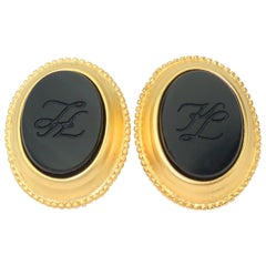 C.1990 Karl Lagerfeld Black Glass Gold Tone Logo Cufflinks