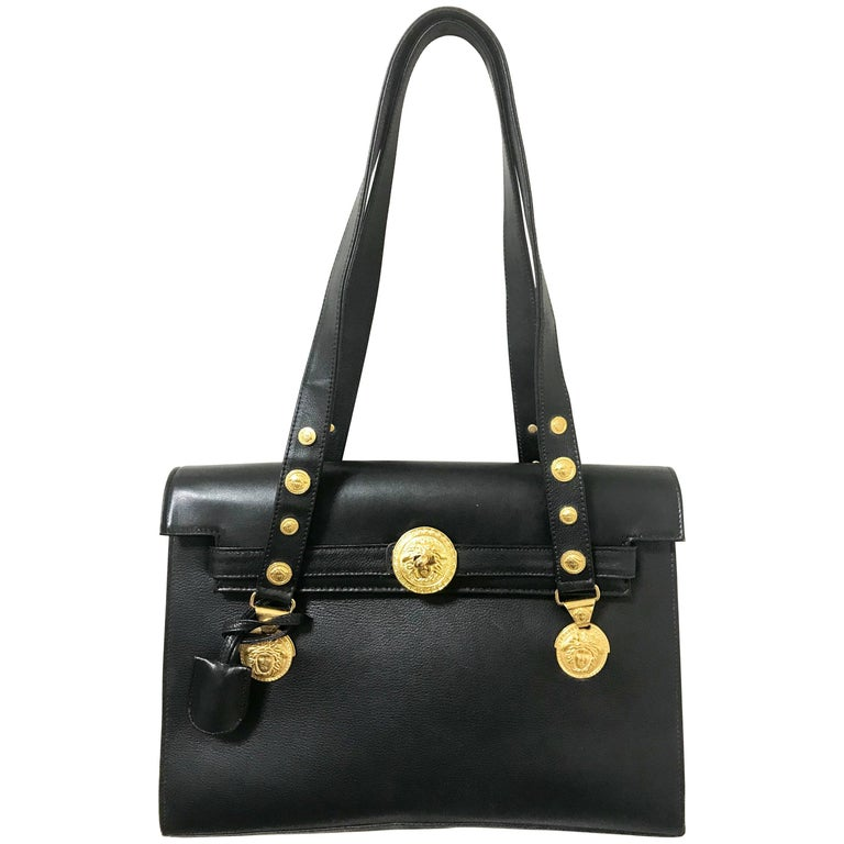 Vintage Gianni Versace black Kelly style shoulder tote bag with golden medusa.