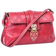 GUCCI Mini Bag in GG Embossed Red Leather