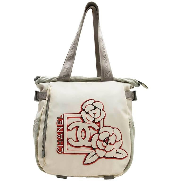 CHANEL Bag in Beige and Grey Canvas with the Chanel Logo and Camellia