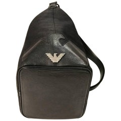 Emporio Armani black canvas with monogram pattern shoulder bag.