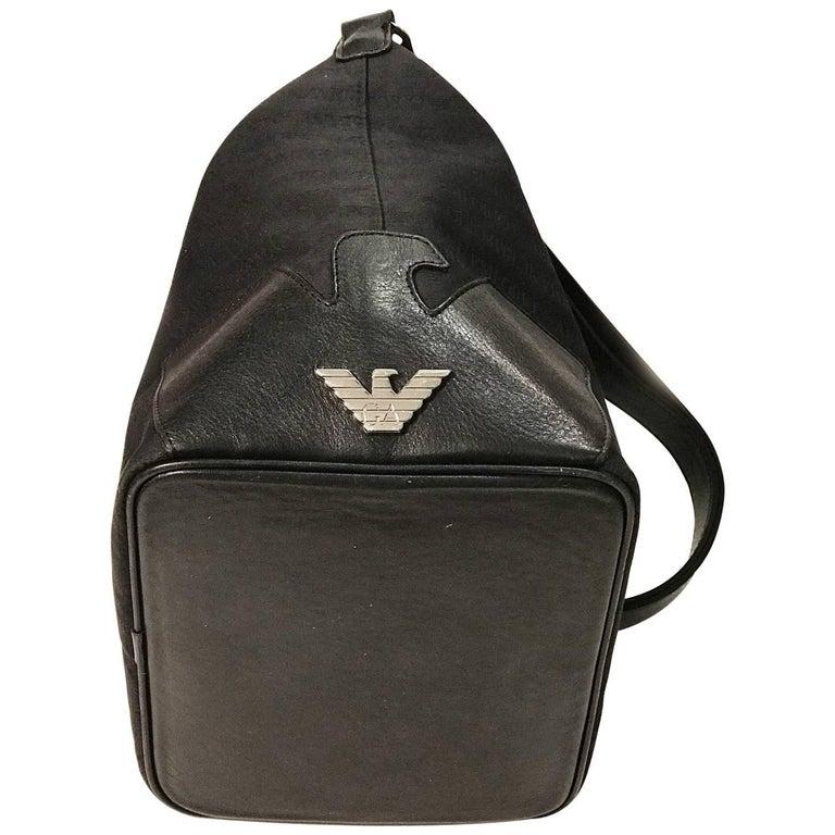 Emporio Armani black canvas with monogram pattern shoulder bag.