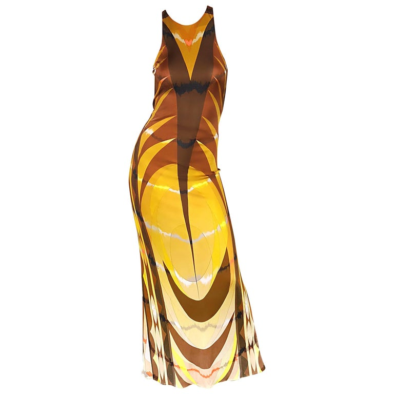 Sexy late 90s EMILIO PUCCI rayon jersey open-back gown! Features warm autumnal tones of brown, mustard yellow, ivory, and pops of pink fuchsia in a slimming abstract print. Soft slinky jersey stretches to fit, and is fully lined. Wonderful tailored