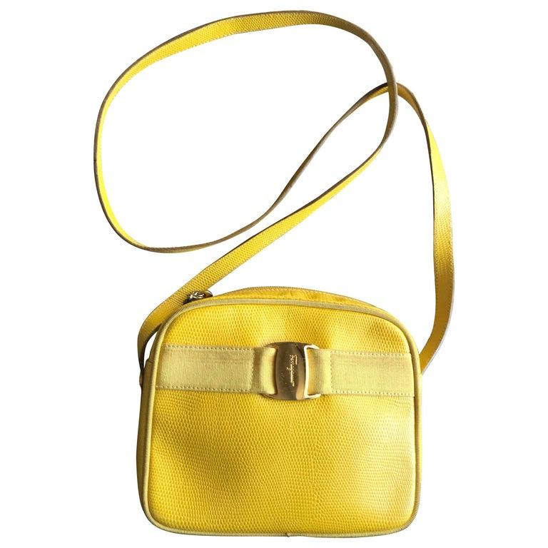 Vintage Salvatore Ferragamo lizard embossed yellow leather shoulder bag. Vara