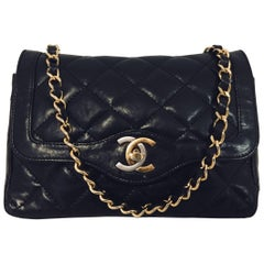 Charismatic Chanel Vintage Black Lambskin 2.55 Flap Bag with Silver & Gold CC