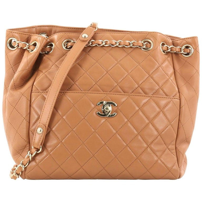 593173fd0d1a Chanel Drawstring CC Lock Quilted Lambskin Small Bucket Bag at 1stdibs