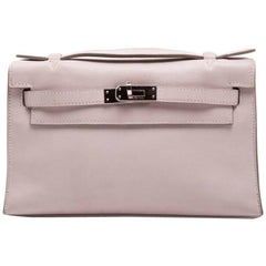 HERMES Kelly Clutch in Pink Swift Calf leather