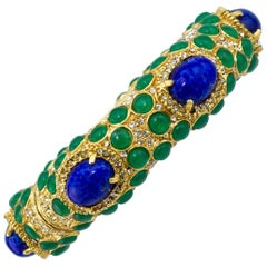 1970s Kenneth Jay Lane Gold Tone Bangle with Green and Blue Cabochon Stones