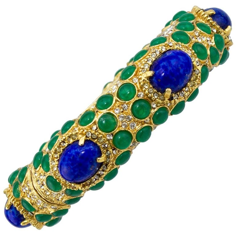 1970s Kenneth Jay Lane Gold Tone Bangle with Green and Blue Cabochon Stones  For Sale