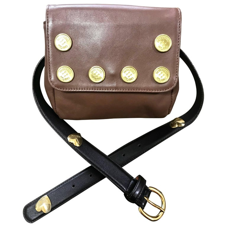 Vintage MOSCHINO brown fanny pack, clutch bag with button motifs and belt.