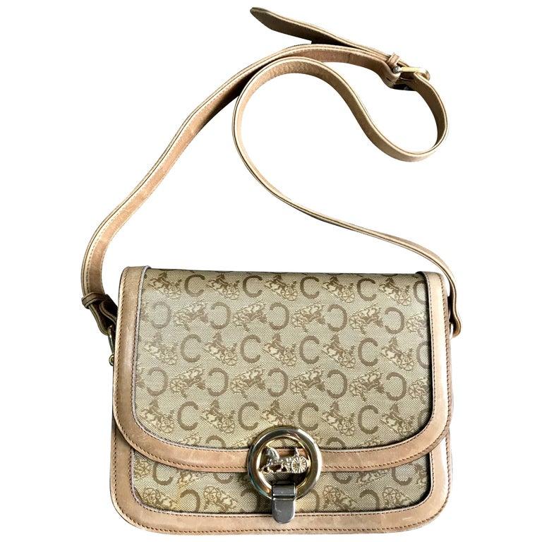Vintage Celine beige macadam and blason pattern shoulder bag with golden motif.