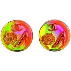 Vintage CHANEL orange aurora earrings with Chanel iconic motif charms.