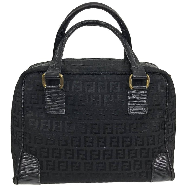 Fendi black logo canvas and leather handbag 1970s For Sale