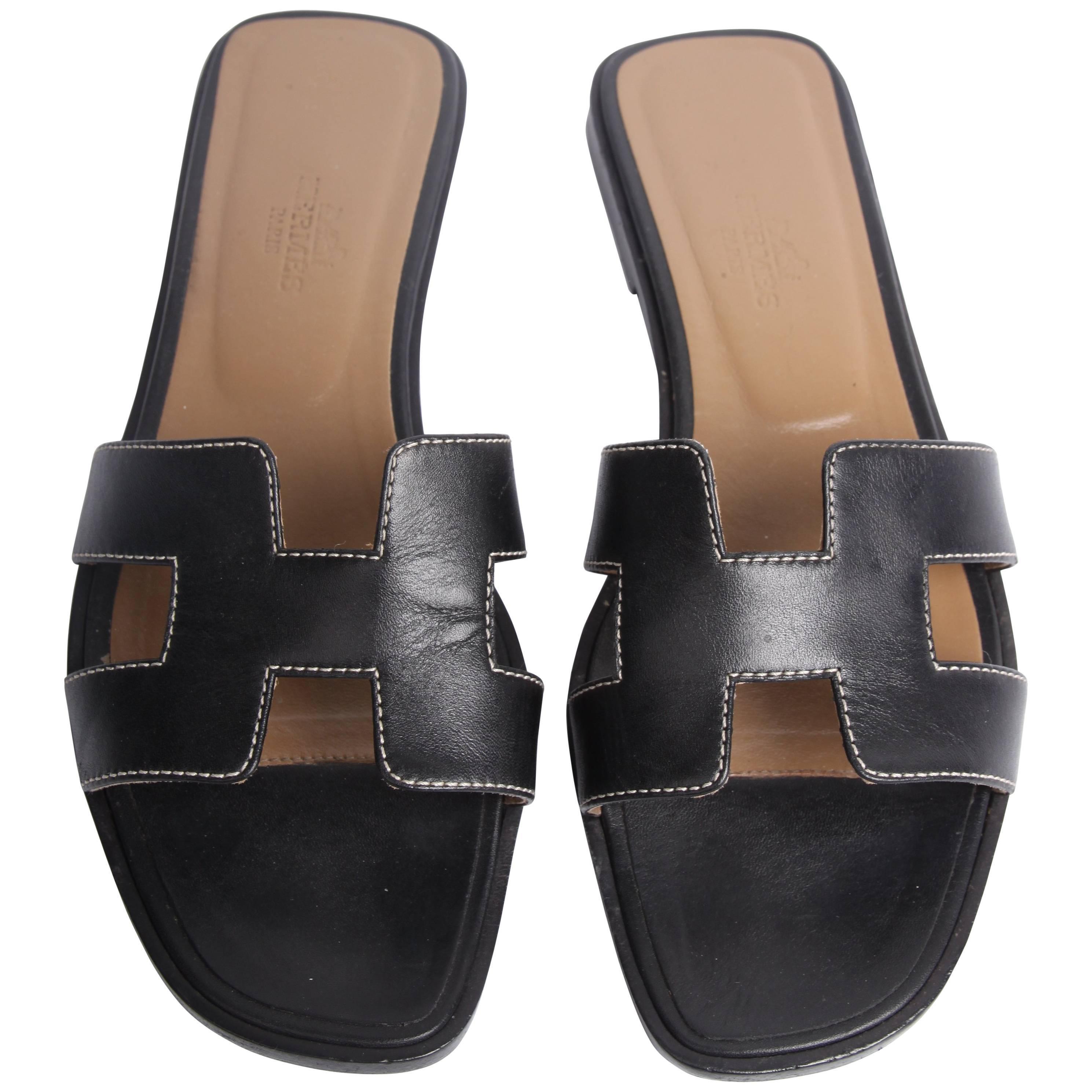 82e4b7e85ba51 Hermes Flat Sandals - black at 1stdibs