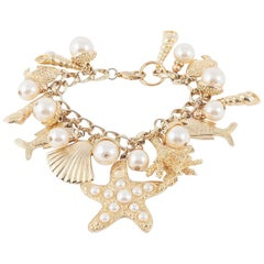 Large gilt metal and paste pearl 'seashell' charm bracelet, USA, 1960s