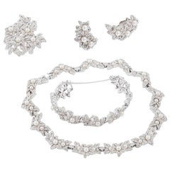 Necklace, earrings, bracelet and brooch, in paste and pearls, by Jomaz, USA.