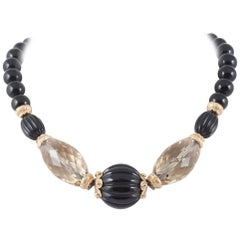 Carved onyx and citrine beaded necklace with silver gilt clasp and beads, 1980s