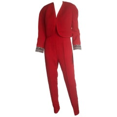 Gianni Versace red jumpsuit and matching glasses cropped bolero jacket