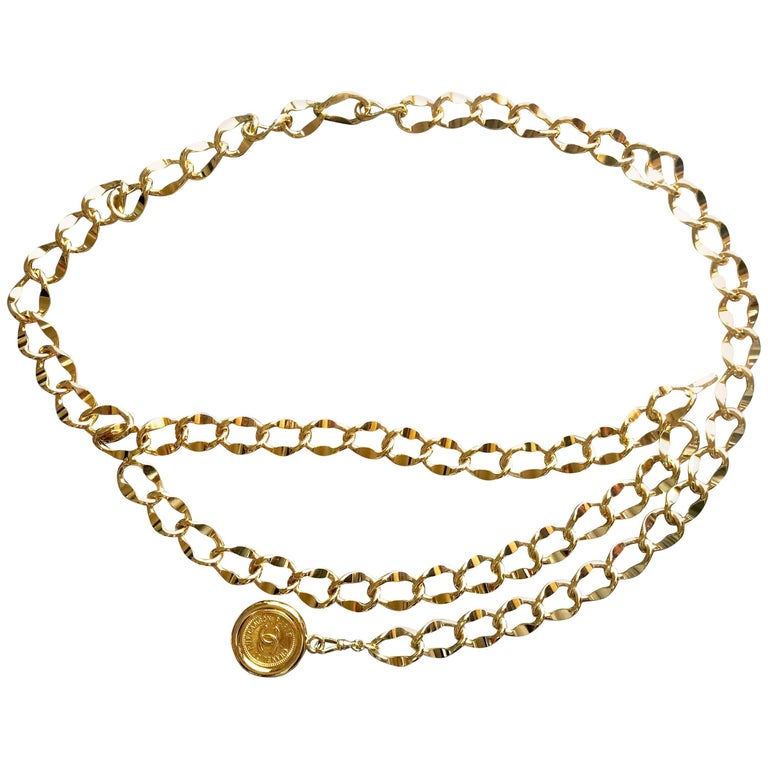 Chanel Vintage golden thick chain belt with a round CC charm, 1980s