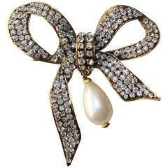 Chanel bow brooch with pearly tear drop, 1980s
