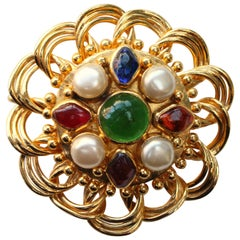 Chanel round gilded metal brooch with multi color cabochons, 1980s