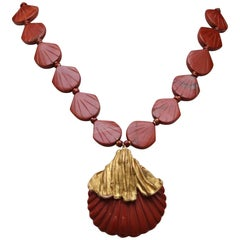 Yves Saint Laurent shell necklace in gilded metal and red jasper, 1970s