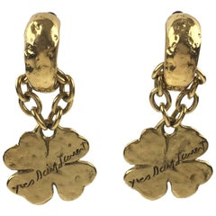 Yves Saint Laurent Paris Gilt Metal Clip on Earrings with Dangling Charm