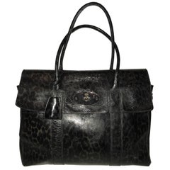 A Mulberry bayswater satchel bag in leopard print patent leather tote blue/black