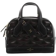 Louis Vuitton Dora Handbag Malletage Leather BB