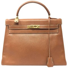 1992,HERMES Vintage  Sac Kelly 32 bag in Courchevel Gold Leather.