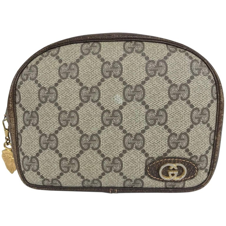 Vintage Gucci small leather and monogram vinyl cosmetic bag  For Sale