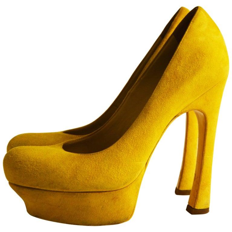 Yves Saint Laurent yellow suede pumps