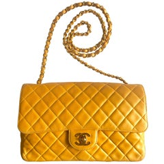 Vintage Chanel classic 2.55 yellow lamb leather shoulder bag with golden CC.